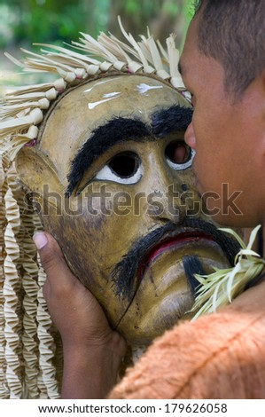 SELANGOR,MALAYSIA - 1 MARCH : An unidentified men holding wooden masks perform, the Mahyin Jo-oh dance during the Ari Moyang celebration. on March 1, 2014 in Selangor, Malaysia.  - stock photo