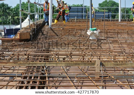 SELANGOR, MALAYSIA -MAY 13, 2016: Hot rolled deformed steel bars or steel reinforcement bar used at construction site to strengthen concrete. It is shaped follow the engineer design.  - stock photo