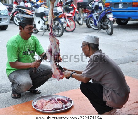 SELANGOR, MALAYSIA-Oct 5: unidentified Muslim prepare meat to distribute to the poor during Eid Al-Adha Al Mubarak, the Feast of Sacrifice on October 5, 2014 in SELANGOR , Malaysia - stock photo