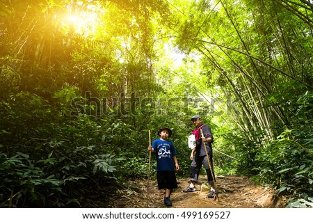 SELANGOR, MALAYSIA - OCTOBER 15, 2016. Group of family hiking to Nuang Mountain at morning. Nuang mountain one of popular among hiker in Malaysia and it is 1439 metres high.