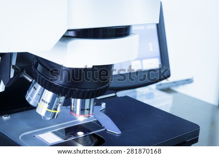 Select focus at Objective lens. Microscopic for science.Medical equipment. Blue tone. - stock photo