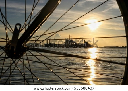 select focus,beautiful landscape on sunset see from bicycle wheel
