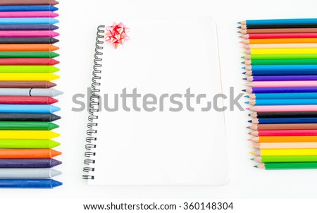 select focus bow.Blank book on white background with various paints, pencils and crayons. - stock photo