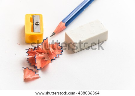 select focus sawdust and  Pencil and eraser put near pencil sharpener isolate on white background - stock photo