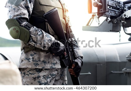 Selected focus army with rifle and machine gun on war ship