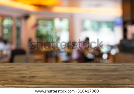 Selected focus empty brown wooden table and Coffee shop blur background with bokeh image. for your photomontage or product display - stock photo