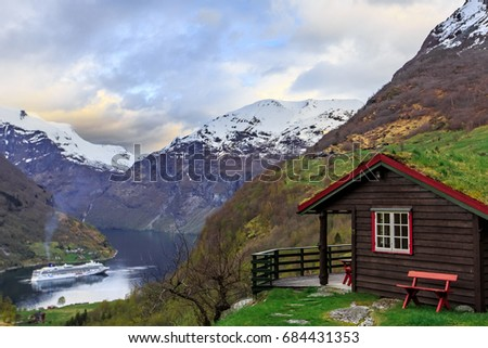 Selected focus on balcony of house with grass on roof, Geiranger  fjord, Norway