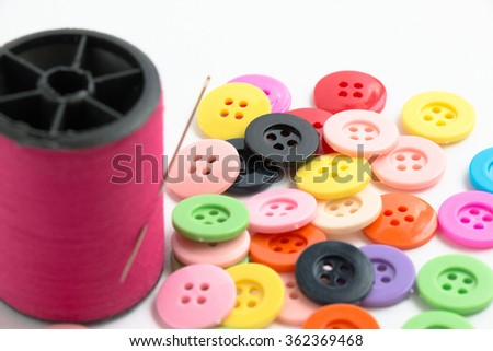 Selected focus on buttons. defocus needle with thread, sew instrument isolated on white background - stock photo
