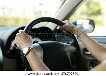 Selected focus Woman is hands on the steering wheel of the car - stock photo