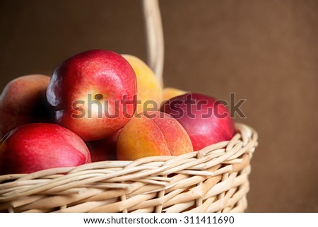 Selected juicy peaches in the pot on the table (close-up view). Fresh fruits on the table. The best choice of Nature mix. Still life of summer. - stock photo