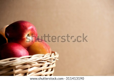 Selected juicy peaches in the Wicker basket. Fresh fruits. The best choice of Nature? mix. Still life of summer. - stock photo