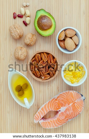 Selection food sources of omega 3 and unsaturated fats. super food high omega 3 and unsaturated fats for healthy food. Almond ,pecan ,hazelnuts,walnuts ,olive oil ,fish oil and avocado .