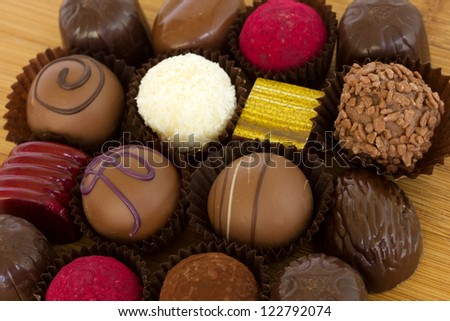 selection of chocolated sweet pralines close up - stock photo