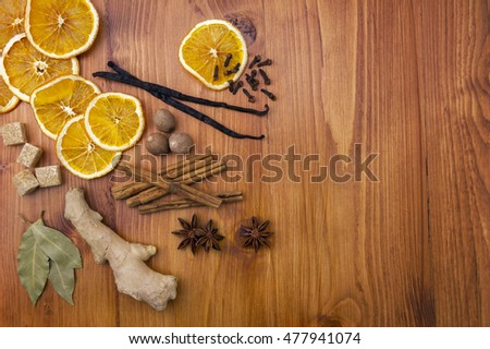 Selection of christmas spices on wood background, top view