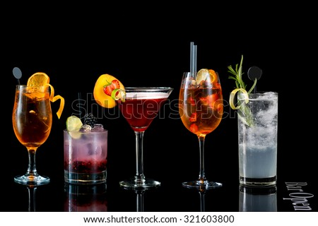 Selection of cocktails black background - stock photo