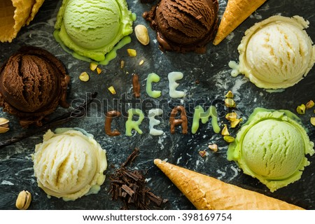 Selection of colorful ice cream scoops in white bowls, copy space - stock photo