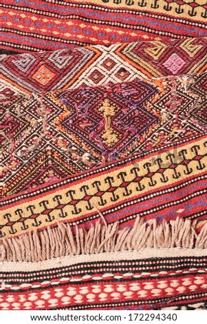Selection of colorful kilim carpets as a background - stock photo