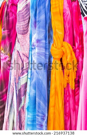 Selection of colorful women's scarves at a market - stock photo