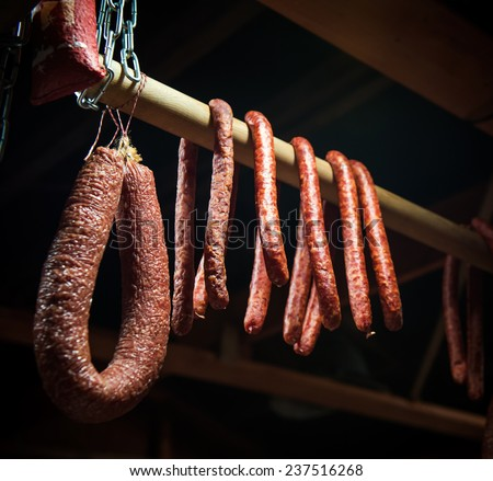 Selection of different types of salami on display - stock photo