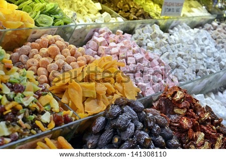 Selection of dried fruits on display at an indoor Grand Bazaar of Istanbul - stock photo