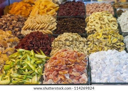 Selection of dried fruits on display at an indoor market stall - stock photo