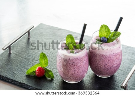 selection of fresh fruit vegetable juice smoothie colors healthy drink tasty  - stock photo