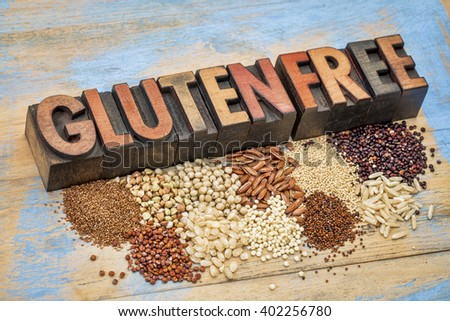 selection of gluten free grains (quinoa, rice, teff, buckwheat, sorghum,kaniwa, amaranth) and text in vintage letterpress wood type  against painted wood - stock photo