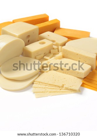 Selection of hard cheeses in blocks and sliced, on white background.  - stock photo