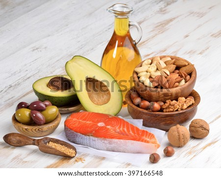 Selection of healthy fat sources on white wood background.  - stock photo