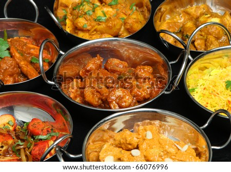 Selection of Indian curries and rice. - stock photo