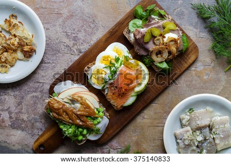 Selection of Nordic open sandwiches with salmon, mackerel and beef