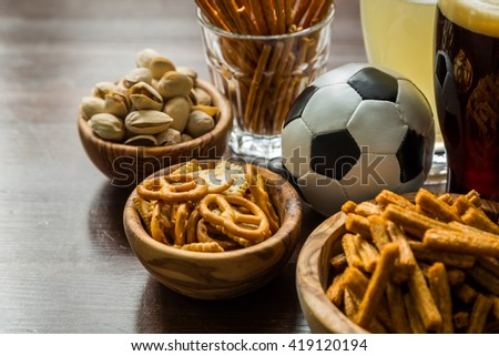 Selection of party food for watching football championship, copy space - stock photo