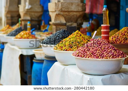 Selection of pickled olives on a traditional Moroccan market (souk) in Essaouira, Morocco - stock photo