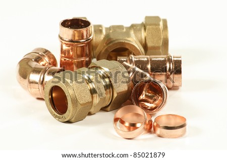 selection of plumbers pipe fittings isolated on a white background - stock photo