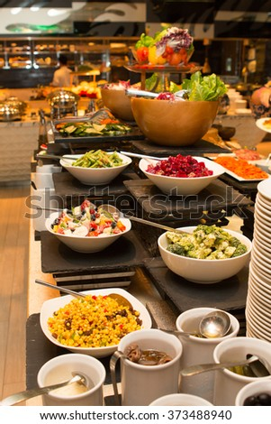 Selection of salads at a buffet bar in a luxury hotel restaurant.