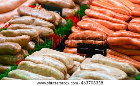 Selection of speciality sausages on display at a butchers counter or delicatessen window