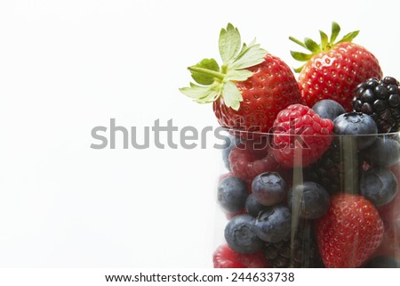 Selection Of Summer Fruits In Glass Against White Background - stock photo