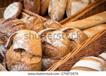 Selection of various cereal homemade breads on display - stock photo