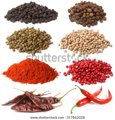 Selection of various peppers on white background - stock photo