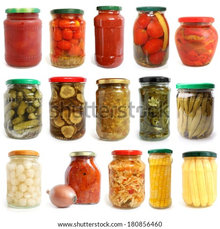 Selection of various vegetables canned in glass jars on white background - stock photo