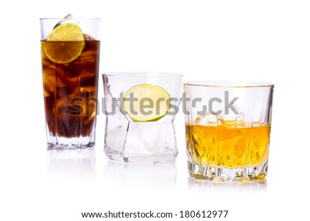 Selection of whiskey on ice over white background