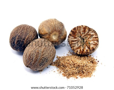 Selection of whole & grated nutmeg on white background - stock photo