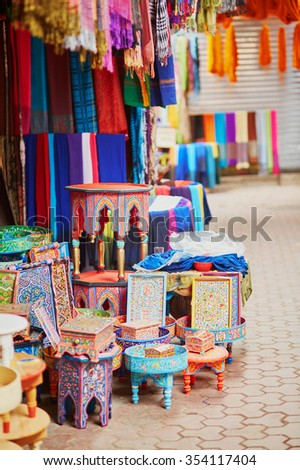 Selection of wooden furniture on a traditional Moroccan market (souk) in Marrakech, Morocco - stock photo