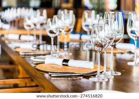 Selectiv soft focus on Wine glass on dining table in restaurant - stock photo