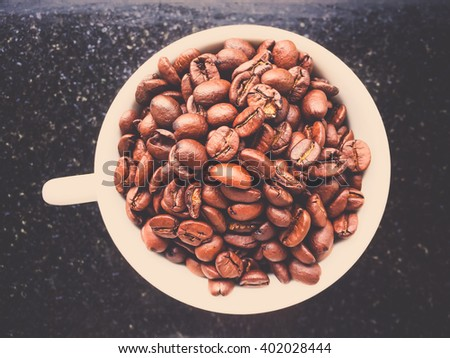 Selective coffee beans in big coffee cup. Selective focused. - stock photo