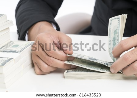 Selective focus and close up at hands of the young bank employee is counting