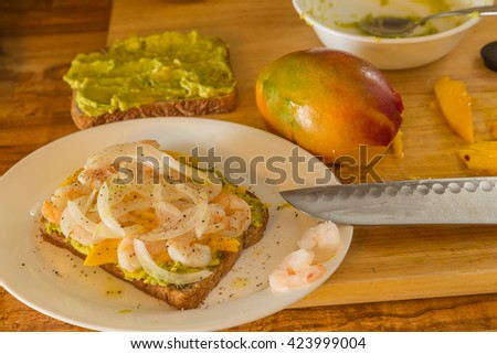 Selective focus and shallow dof on ingredients for shrimp sandwich with mango and avocado. - stock photo