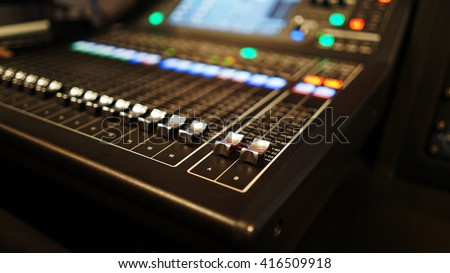 selective focus buttons equipment for sound mixer control with blurry background - stock photo