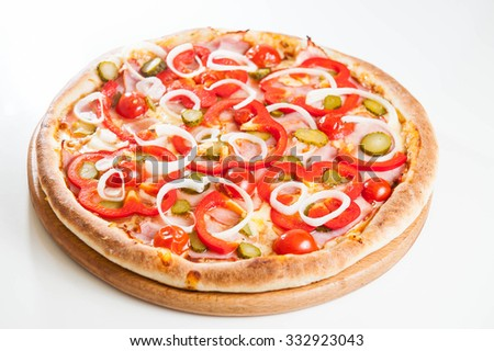 Selective focus Close up Hot  bacon pizza with vegetables on the wooden board isolated