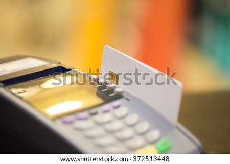 Selective Focus : Close Up Of Electronic Chip Credit Card With Credit Card Machine - stock photo